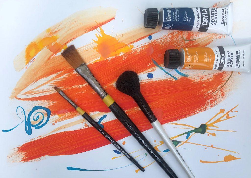 online art classes bright orange paint paint brushes acrylic paint